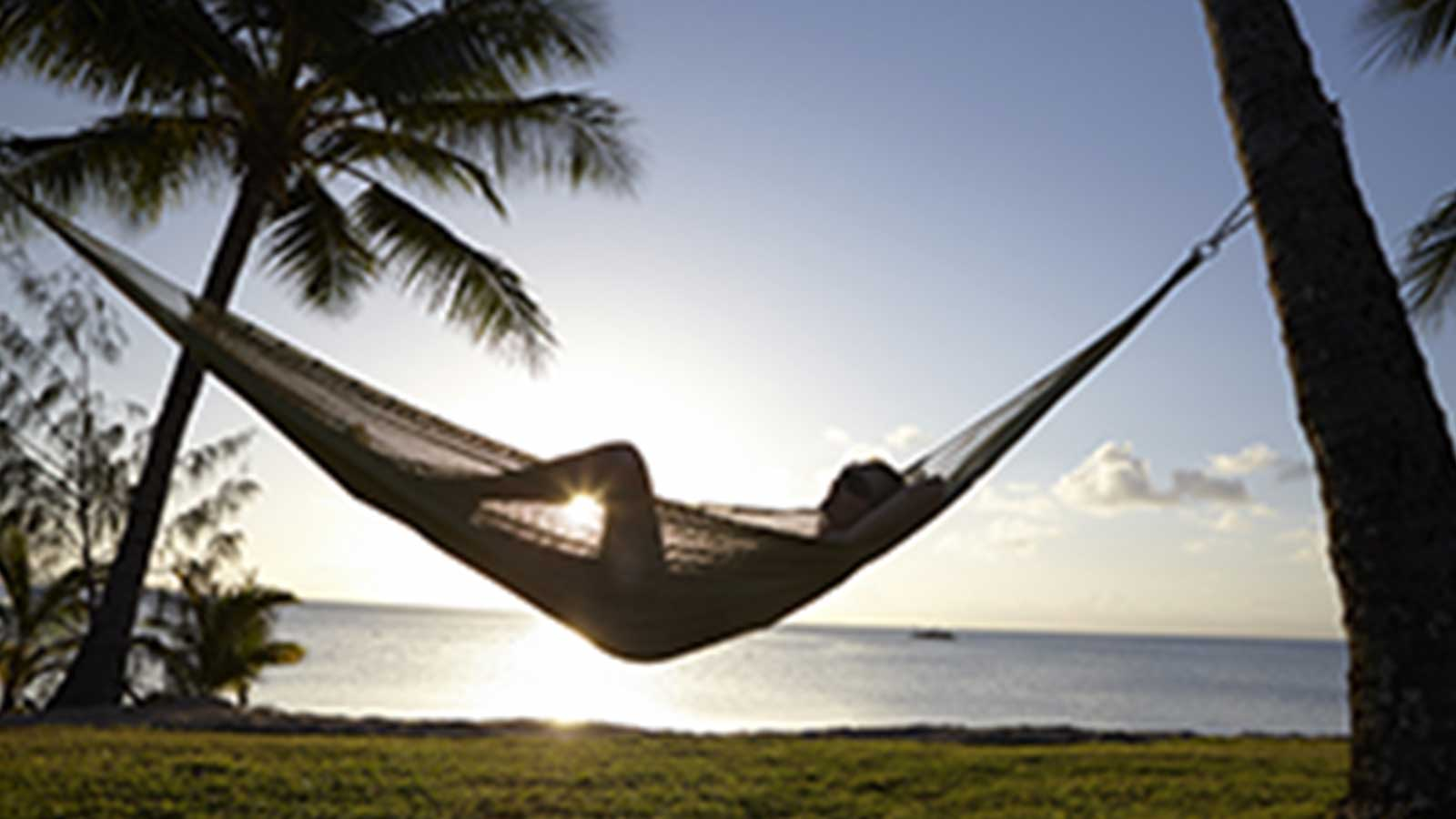 relaxing in hammock at sunset