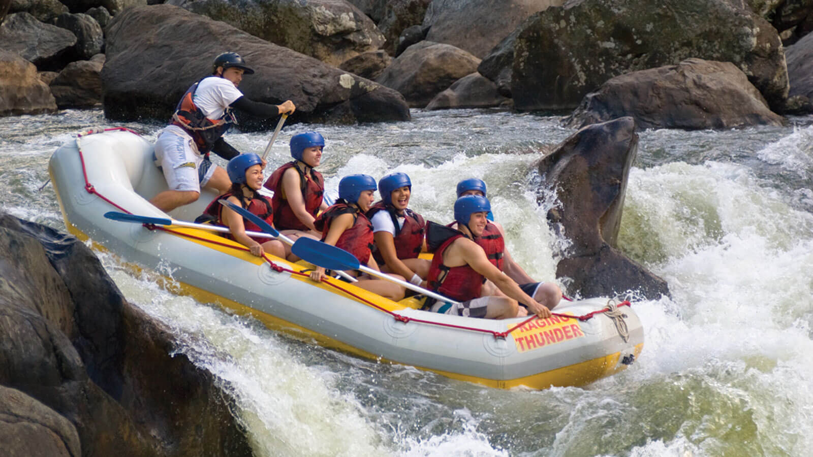 Raft going over the rapids