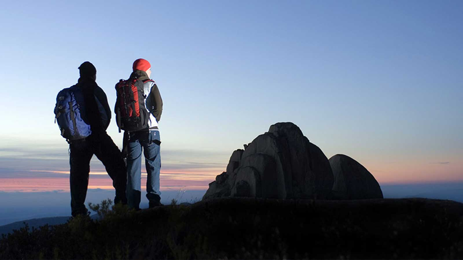 hikers with a sunrise view
