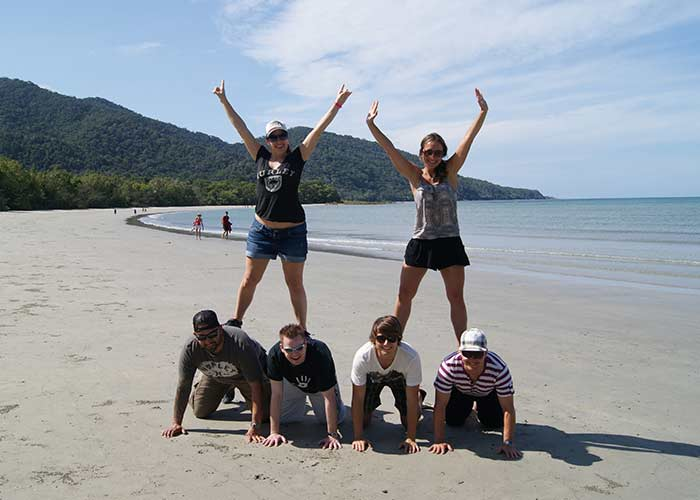 Human pyramid on the beach