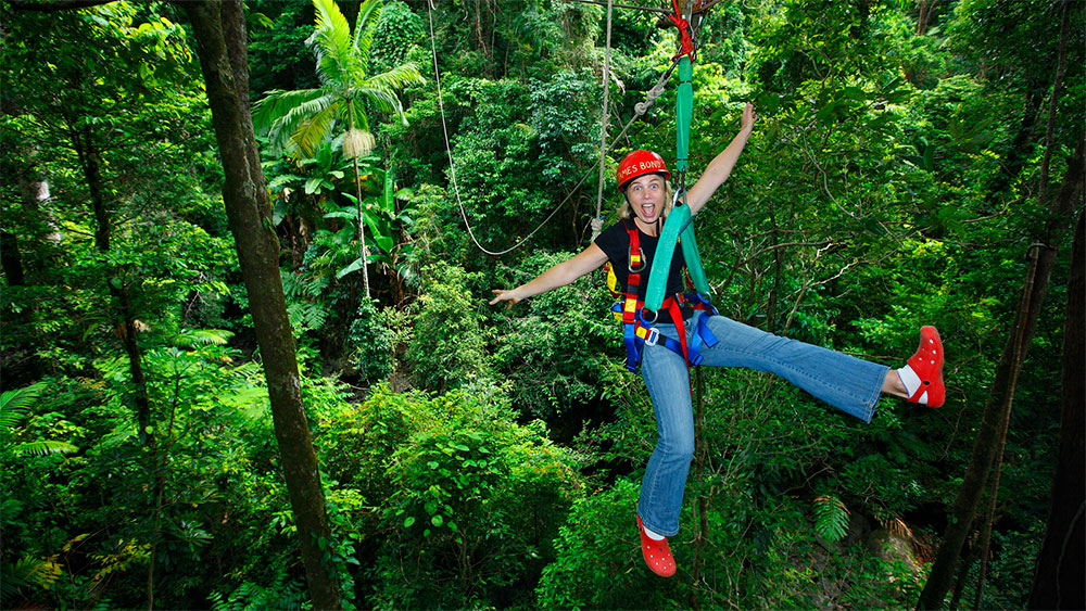 Girl zipping through the jungle