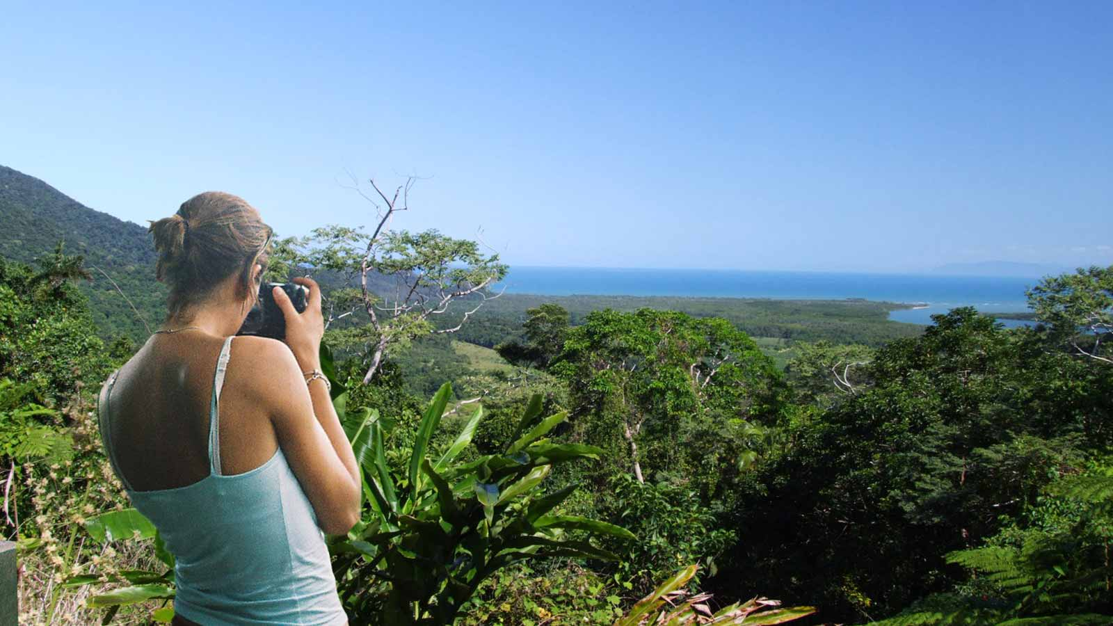 Taking a photo of the rainforest and ocean scenery