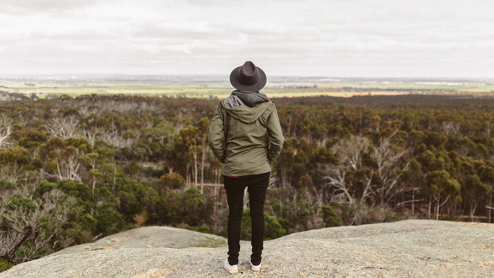 viewing the scenery on a rock